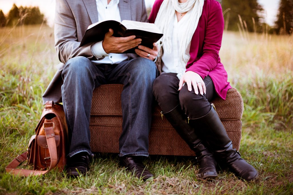 married-couple-reading-the-bible-together-praying-together