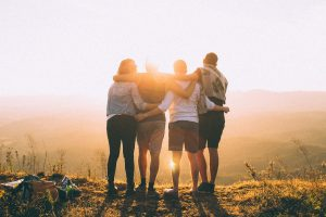 family-in-front-of-sun
